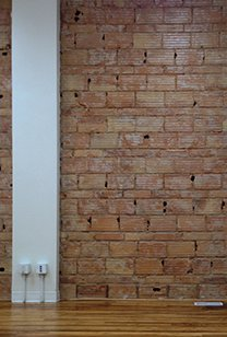 Exposed Brick wall with electrical outlet