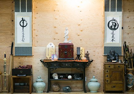 Shrine against plywood wall