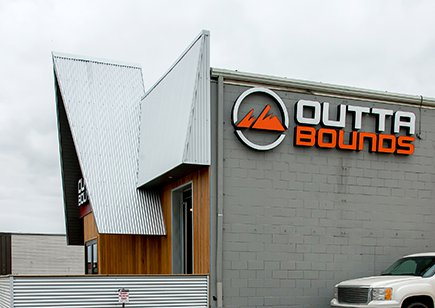 Side of Exterior of Outtabounds building with A frame entrance