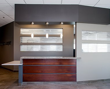 Reception with frosted glass windows and wood desk