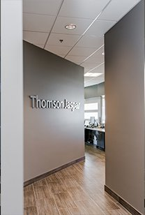 Door to office with title: Thomson Room