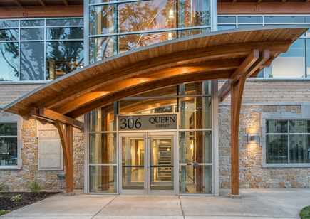 Curved Timber Beams with Metal Entrance Way