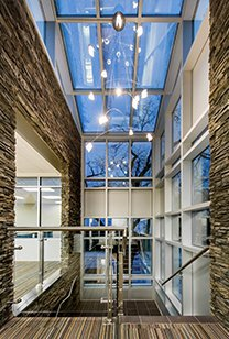 Large entry way with rock walls and skylight