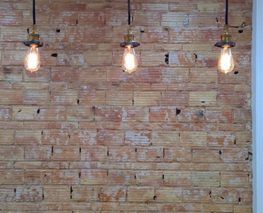Exposed Brick wall with three retro light bulbs