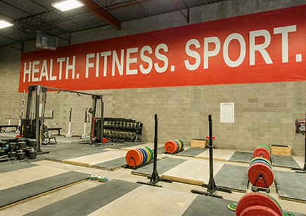 Exercise room with wall slogan: Health Fitness Sport